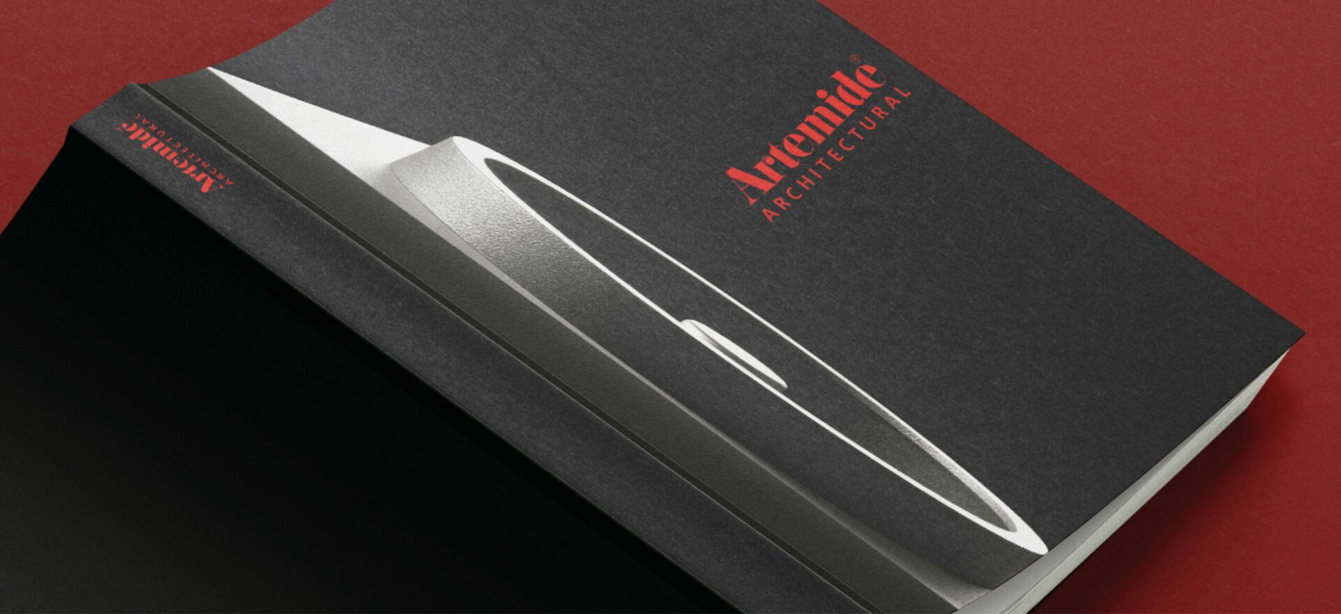 Greyscale Catalog for Artemide Architectural, light design with Logo in red color in a red background.