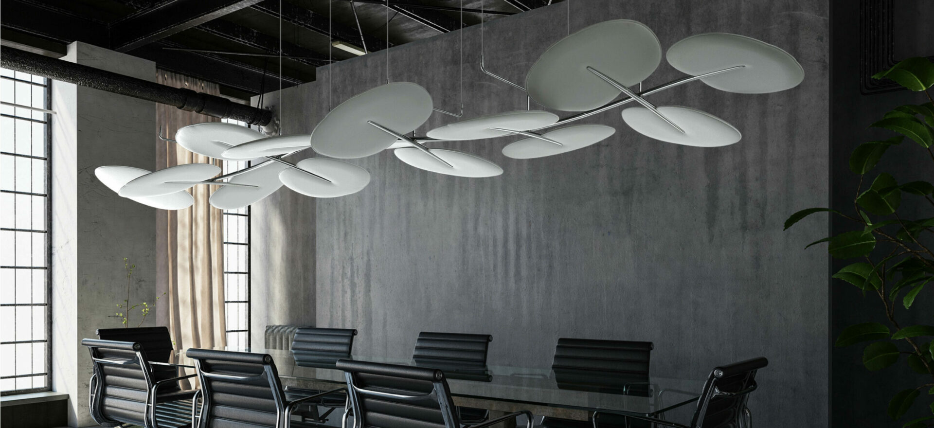 Photo of Botanica sound absorving panels designed by Mario trimarchi for Caimi Brevetti, in white texture on a meeting room ambience. The panels are showned in a metal structure hanging from the ceiling.