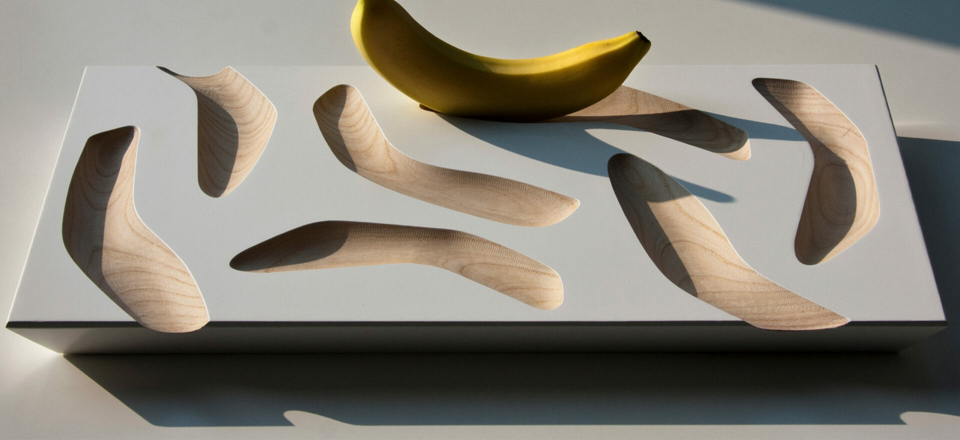 Oggetti Smarritti center piece by Mario Trimarchi in an architectural style showing details related the concave forms to hold fruits.