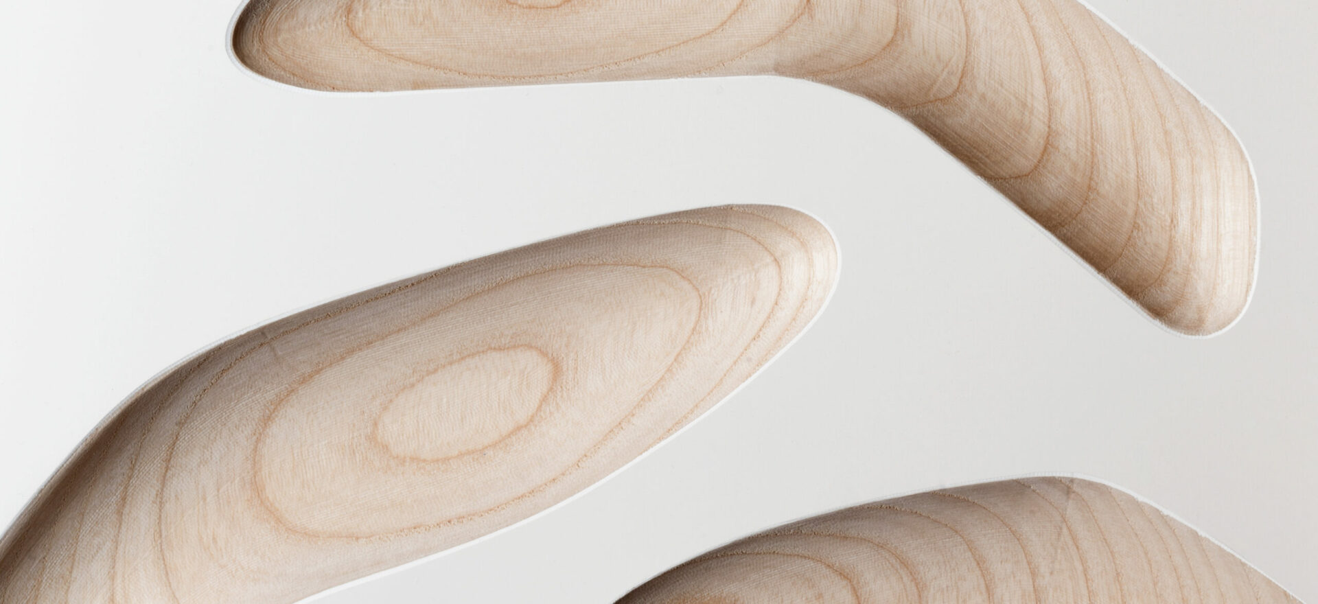 Oggetti Smarritti center piece by Mario Trimarchi with an architectural style showing details related the concave forms of wood to hold fruits.