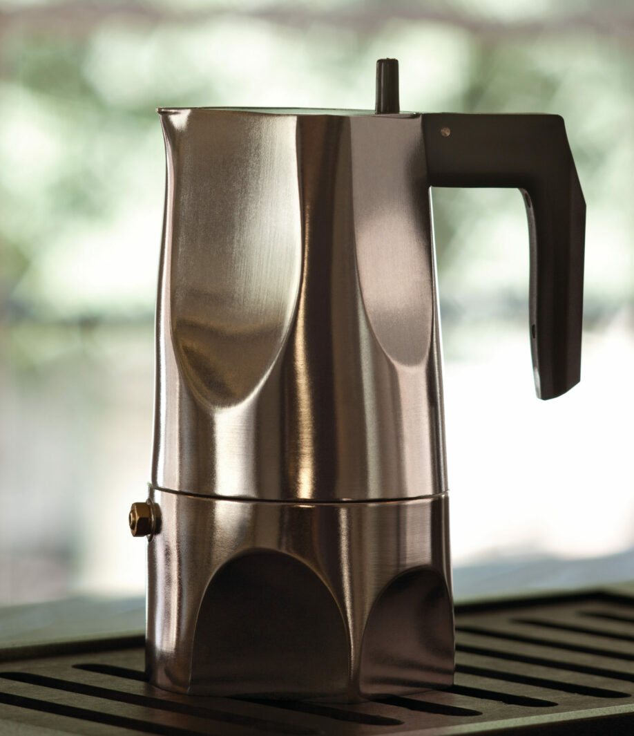 Left side photo of Ossidiana Expresso Coffee maker for Alessi. The model presented in the picture is in aluminium casting with handle in thermoplastic black resin, showing the details of its form inspired in the stone arrowheads handmade by natives.
