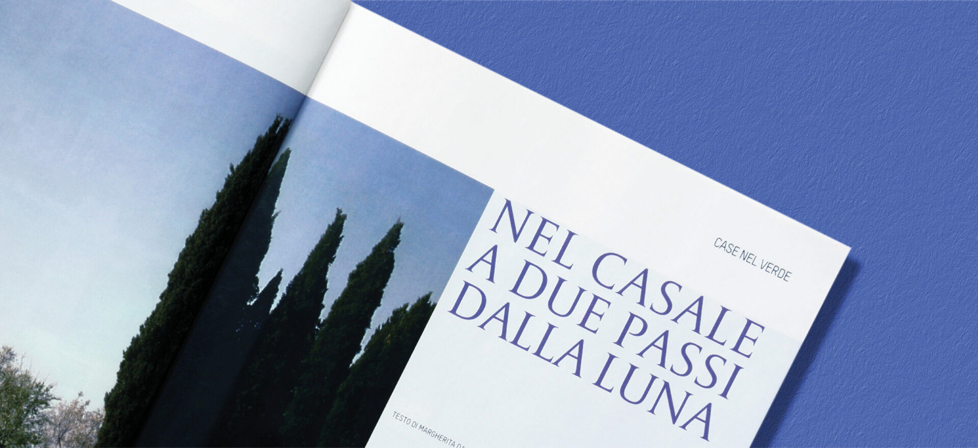 Close up photo of an opened Ville Giardini Magazine showing detail of the typography and composition of text and images used in the project of the Art Direction and Graphic Design for Visibilia Editore in a light blue background.